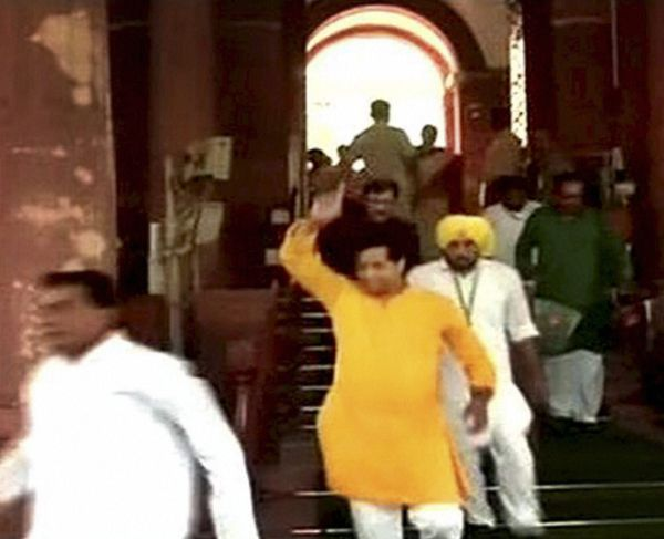 TMC and AAP members leave after a protest in the Lok Sabha.