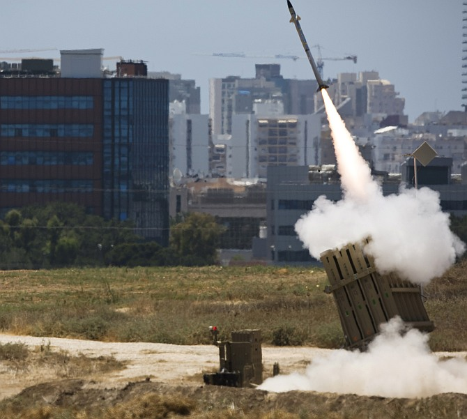 An Iron Dome launcher fires an interceptor rocket in the southern Israeli city of Ashdod July 11
