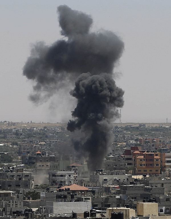 Smoke rises following what witnesses said was an Israeli air strike in Rafah in the southern Gaza Strip July 11
