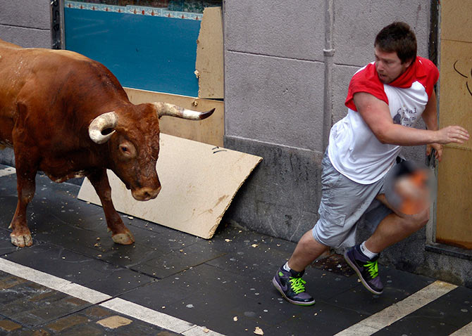 PHOTOS: Why a bull chasing you is not really fun