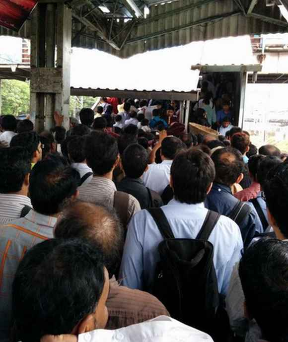 Railway stations witnessed heavy rush during peak hours as suburban trains were running late