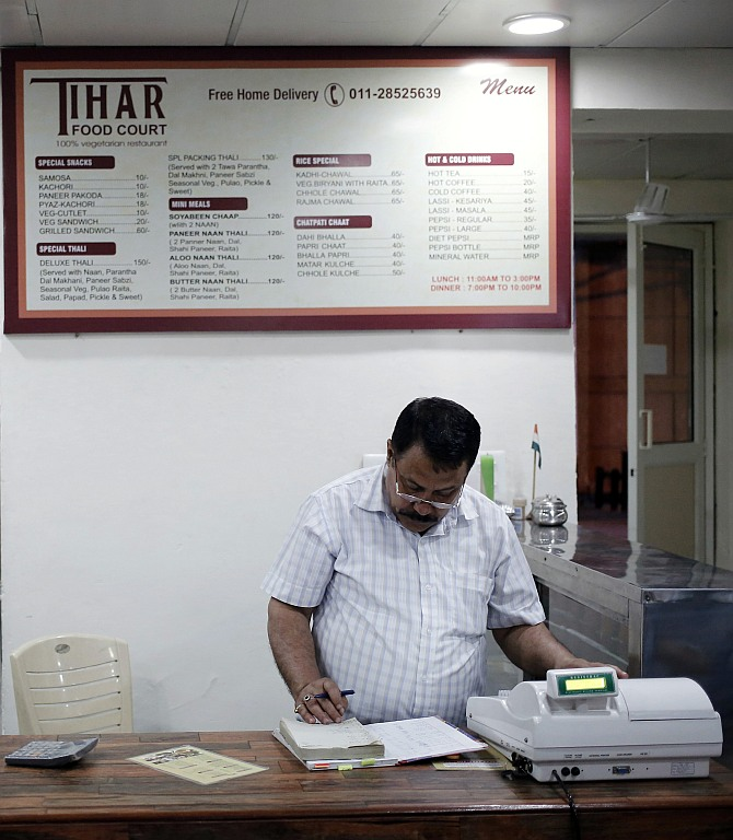 Kishan Singh Bisht, a jail warden in Tihar, maintains a register inside a restaurant run by the Tihar Jail authorities on Jail Road in west Delhi