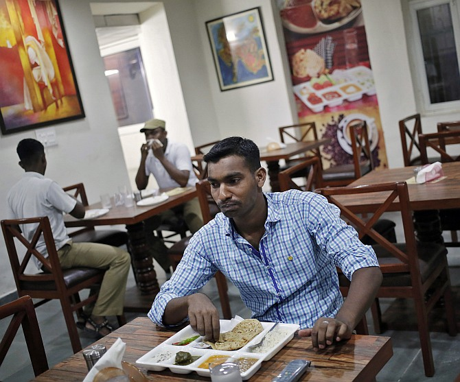 Customers eat inside a restaurant run by the Tihar Jail authorities on Jail Road in west Delhi