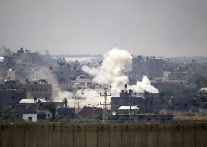 Smoke is seen after an Israeli strike over the Gaza Strip July 22, 2014. Israel pounded targets across the Gaza Strip.