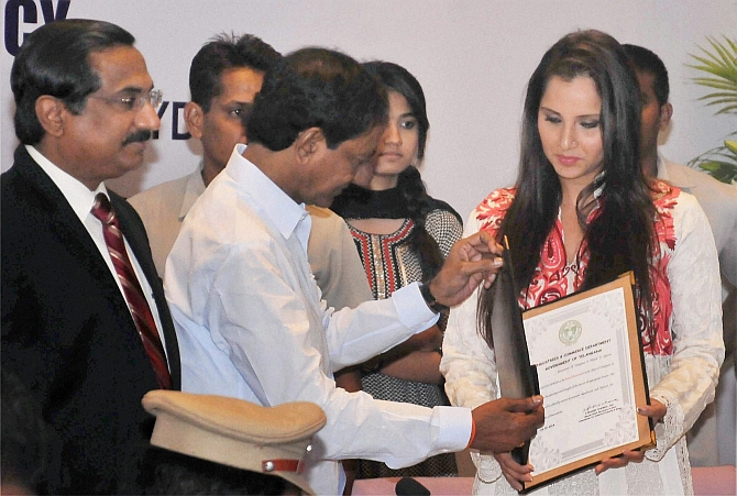 Telangana CM K Chandrashekhar Rao presents a letter of appointment as the brand ambassador of the state to Sania Mirza at ITC Kakatiya in Hyderabad on Tuesday