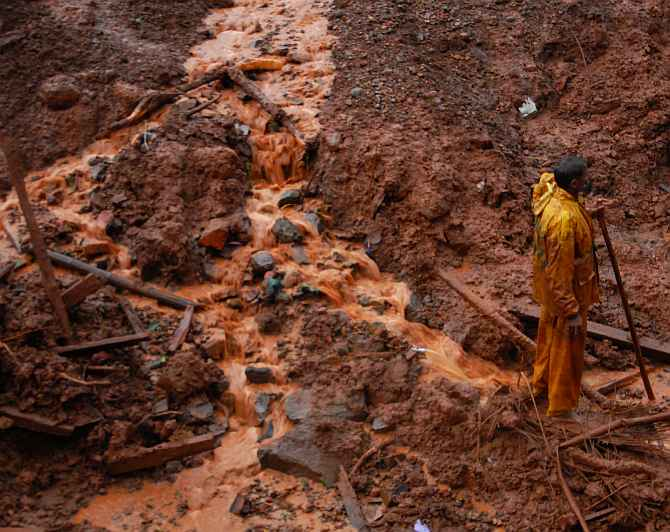 A rescue worker at site of the landslide near Pune on Wednesday