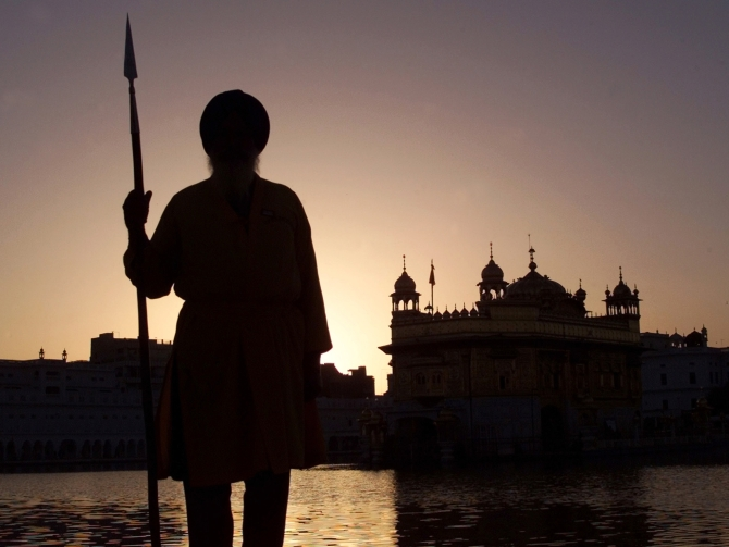 A Sikh temple worker stands guard inside the Golden Temple complex in Amritsar, in Punjab, in this photograph taken on March 5, 2003.