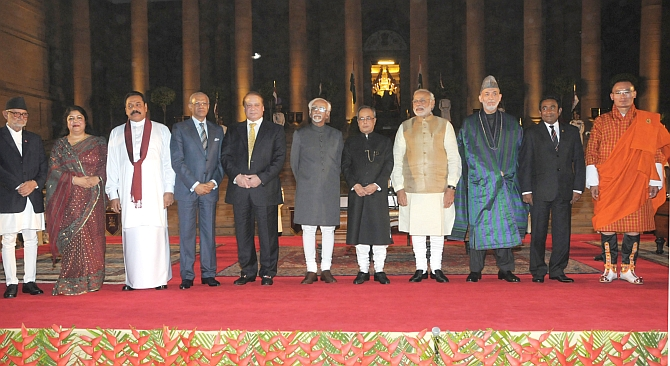 Then Nepal prime minister Sushil Koirala, Bangladesh Speaker Shirin Sharmin Chaudhury, then Sri Lanka president Mahinda Rajapaksa, then Mauritius president Navin Ramgoolam, then Pakistan prime minister Nawaz Sharif, then vice-president Hamid Ansari, then President Pranab Mukherjee, Prime Minister Narendra D Modi, then Afghanistan president Hamid Karzai, Maldives President Yameen Abdul Gayoom and Bhutan Prime Minister Tshering Tobgay soon after the Modi government was sworn in, May 26, 2014. Photograph: Press Information Bureau