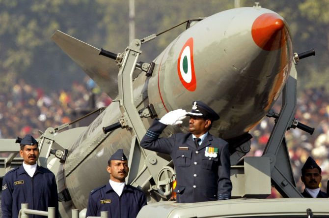 Indian soldiers stand beside India's surface-to-surface missile, Prithvi