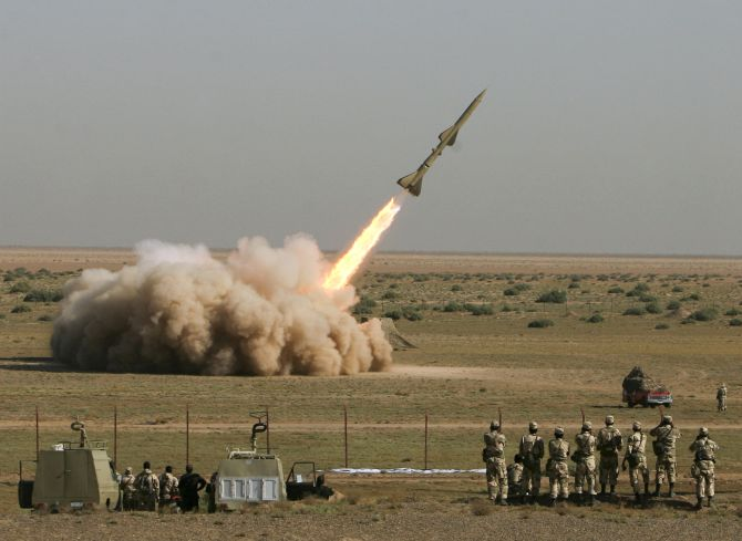 An Iranian Tondar missile is launched during a test at an unknown location in central Iran