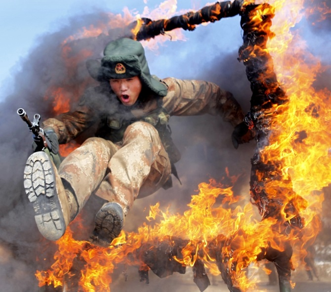 A frontier soldier from the People's Liberation Army undergoes training in Heihe, Heilongjiang province