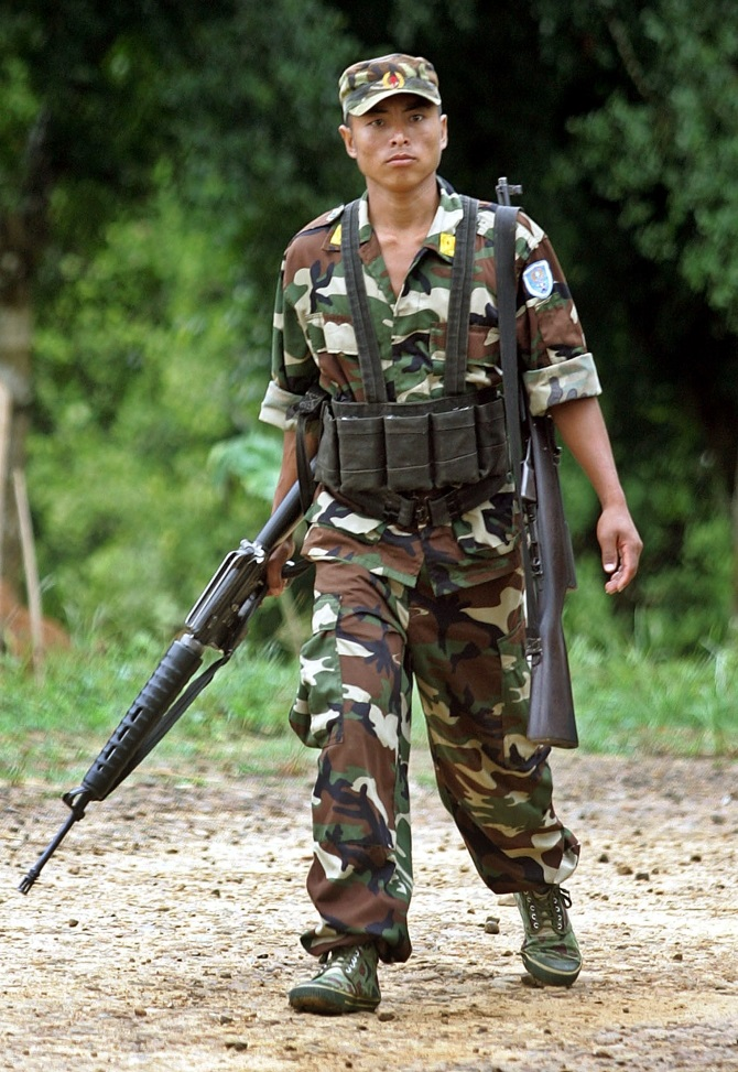 A Naga rebel patrols the inside of Hebron Camp in Nagaland. Rebels from the hill tribes of Nagaland fought a fierce insurgency against India for five decades until a ceasefire in 1997