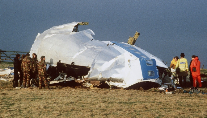 Scottish rescue workers and crash investigators search the area around the cockpit of Pan Am flight 103 in a farmer's field east of Lockerbie, Scotland.