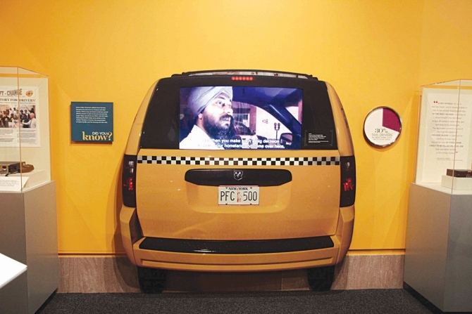 A display depicting an Indian cabbie in New York.
