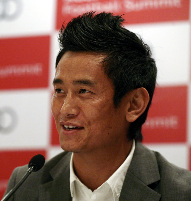 Former India soccer team captain Baichung Bhutia speaks during a news conference in New Delhi