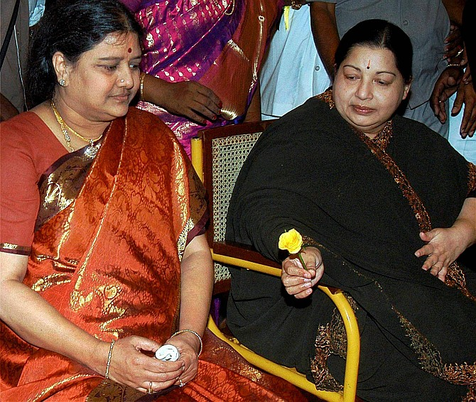 Sasikala Natarajan, left, with J Jayalalithaa