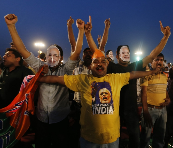 Supporters of Hindu nationalist Narendra Modi, prime ministerial candidate for the Bharatiya Janata Party and Gujarat's chief minister, cheer before the start of a rally