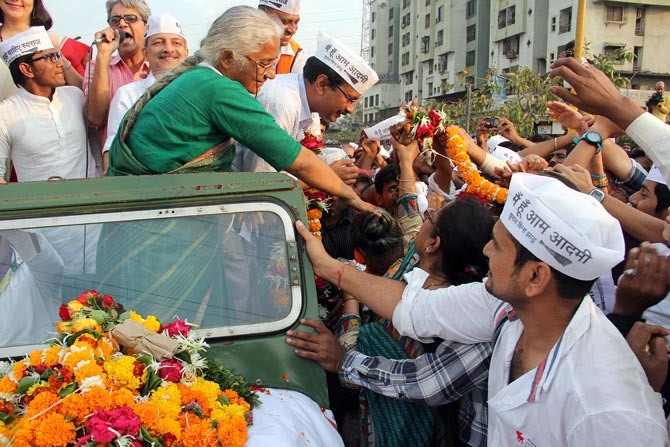 Medha Patkar greets supporters along with AAP leader Arvind Kejriwal during the latter's recent visit to Mumbai.