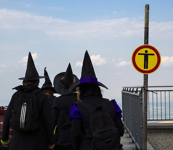 Women dressed up as a witches walk at the summit of Brocken mountain in the Harz region celebrating the Walpurgisnacht pagan festival