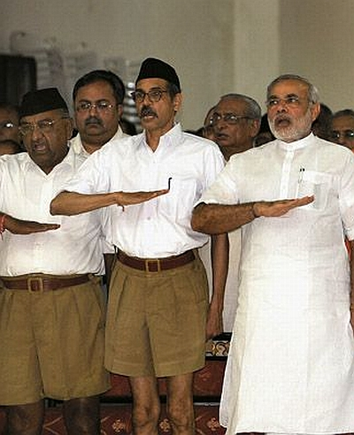 Narendra Modi, right, with RSS activists. Indresh Kumar says, 'This movement started in 2002 and Modi is in the line of prime ministership only for the last couple of years.'