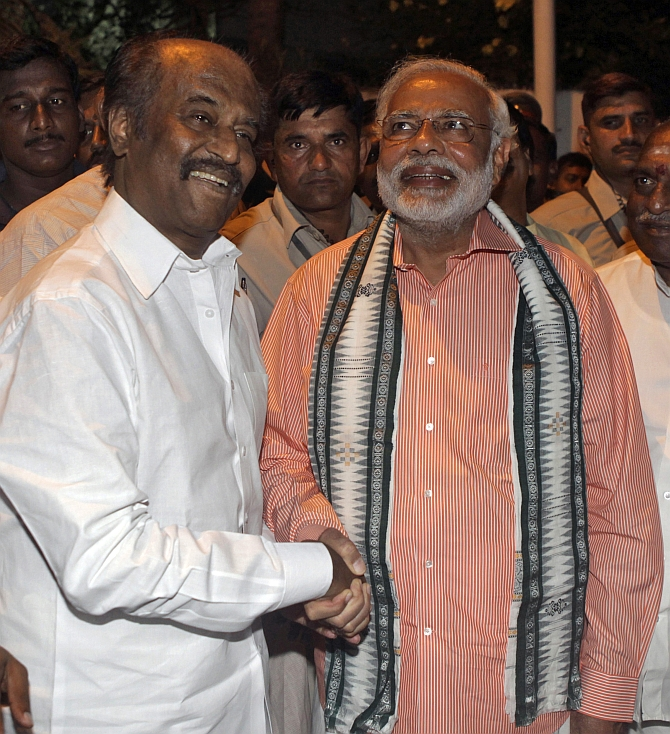 BJP's PM candidate Narendra Modi and film star Rajinikanth share a light moment in Chennai.