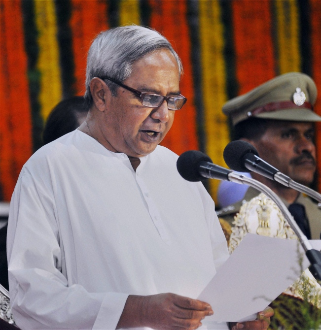 Naveen Patnaik is sworn in as Odisha's chief minister for the fourth time, May 21, 2014. The Biju Janata Dal won 117 of the 147 assembly seats and 20 of the 21 Lok Sabha seats in the 2014 election. Photographs: PTI Photo