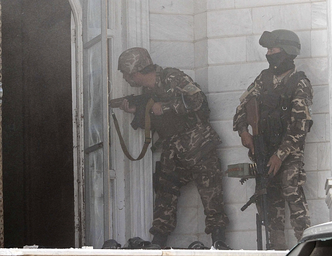 Afghan security forces take position at the scene of the attack on the Indian consulate in Herat. Photograph: Mohammad Shoib/Reuters
