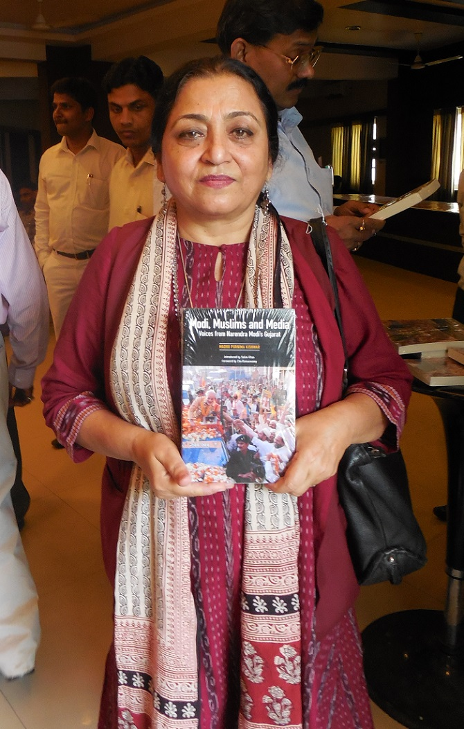 Madhu Kishwar with her book, Modi, Muslims and Media.