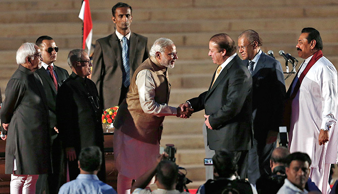 Prime Minister Modi greets his Pakistani counterpart, Nawaz Sharif.