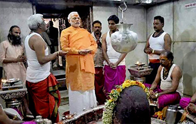 Narendra Modi participates in a puja at the Kashi Vishwanath temple in Varanasi.