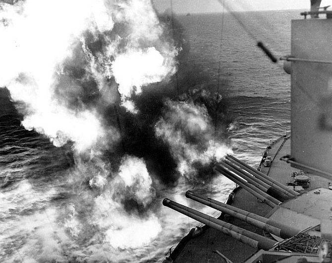 Forward 14'/45 guns of USS Nevada (BB-36) fire on positions ashore, during the landings on 'Utah' Beach