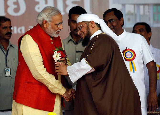 Narendra Modi receives flowers from a Muslim cleric.