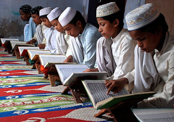 Muslim children read the Quran at a madrasa.