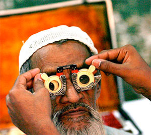 A man gets his eyes tested in a free camp.
