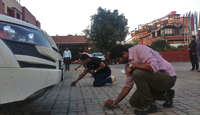 A puja and time to break a few coconuts -- one for each Mahindra SUV -- before setting out from Kathmandu.