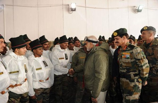 Prime Minister Narendra Modi with soldiers at the Siachen glacier, October 23, 2014.