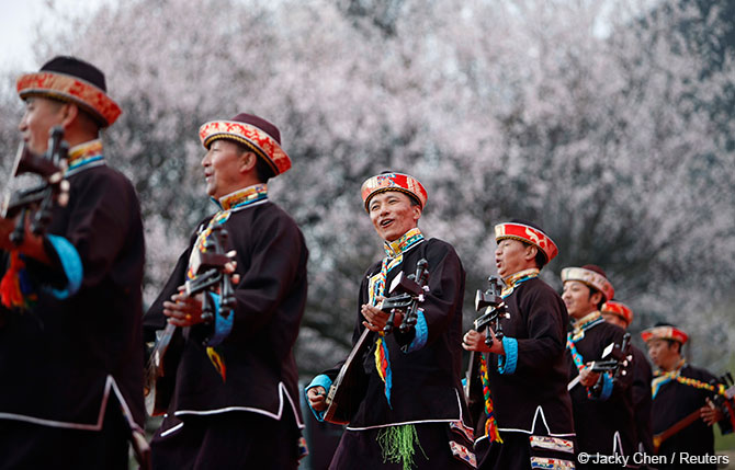 Tibetans play their traditional musical instruments to commemorate Serfs Emancipation Day in Nyingchi Prefecture, Tibet