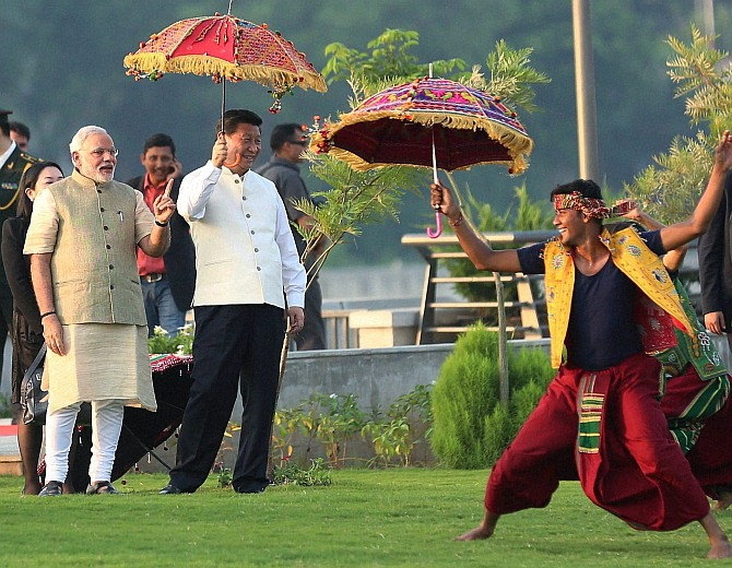 Prime Minister Narendra Modi and Chinese President Xi Jinping watch a cultural performance in Ahmedabad, September 17. Photograph: PTI Photo