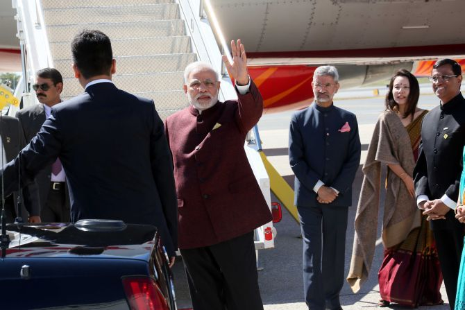 Foreign Secretary Dr S Jaishankar, then India's ambassador to the United States, near the stairs of the aircraft with his wife Kyoko Jaishankar and India's then consul general in New York Ambassador Dynaneshwar Mulay during Prime Minister Narendra Modi's visit to the US in September 2014. Photograph: Mohammad Jaffer/SNAPSIndia