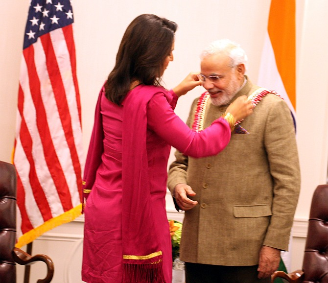 Tulsi Gabbard with Narendra Modi when the Indian prime minister visited the US in September 2014. Photograph: Mohammed Jaffer/SnapsIndia