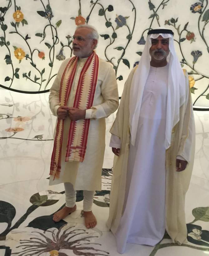 Indian Prime Minister Narendra Modi with Sheikh Nahyan bin Mubarak, Minister of Culture, Youth and Community Developmentk, at the Sheikh Zayed Grand Mosque.