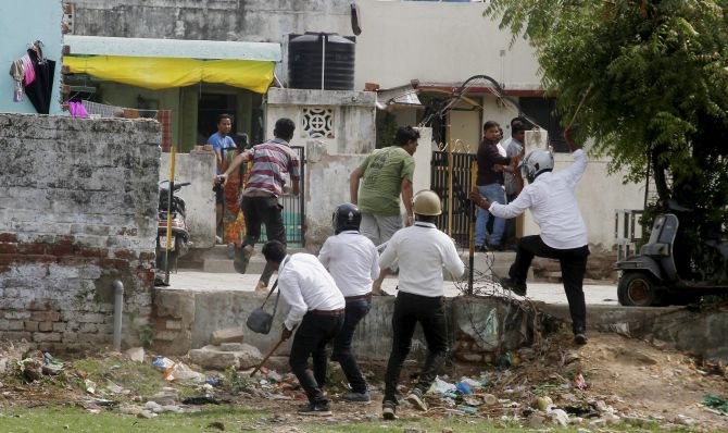 Police resort to a lathicharge after violent clashes in Ahmedabad. Photograph: PTI Photo