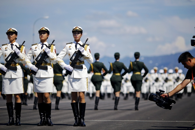 People's Liberation Army soldiers march in Beijing. Photograph: Damir Sagolj/Reuters