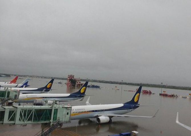 Aircraft stranded at the flooded Chennai airport. Photograph: @harikiranroyal/Twitter
