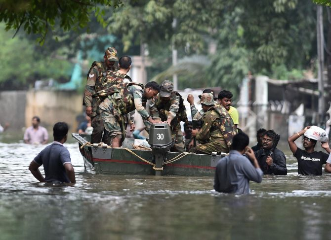 Army personnel rescue residents from a flooded area in Chennai. Photograph: PTI