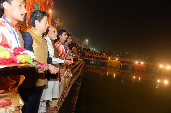 Prime Minister Narendra Damodardas Modi with Japanese Prime Minister Shinzo Abe at the Ganga Aarti in Varanasi, December 12, 2015. Photograph: PTI Photo