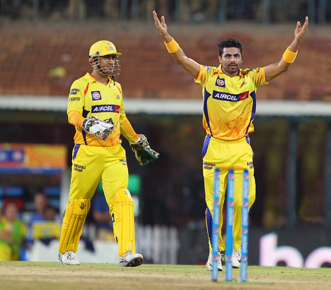 Ravindra Jadeja of Chennai Super Kings appeals as captain MS Dhoni looks on