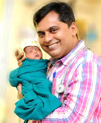 Dr Ganesh Rakh with a new-born baby girl