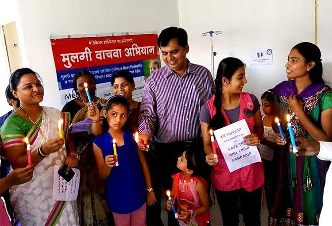 Dr Ganesh Rakh, a Pune doctor who delivers girl children free of charge, at a campaign to save the girl child.