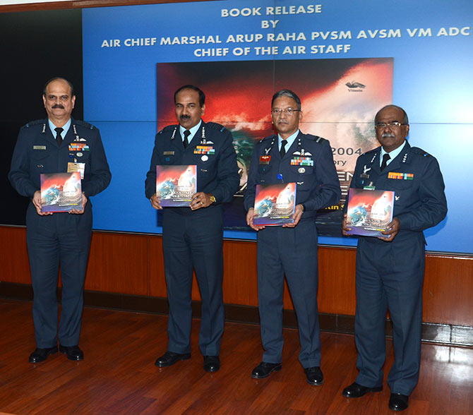 Air Chief Marshal Arup Raha, second from left, with Air Commodore Nitin Sathe, the author, second from right.